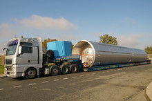 Oversize Load Or Exceptional Convoy. A Truck With A Special Semi-trailer For Transporting Oversized Loads.