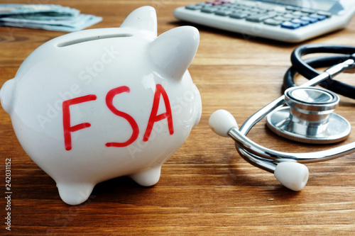 Valokuva  Piggy bank with words Flexible Spending Account FSA.