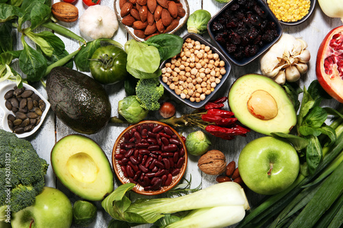 Poster Cuisine Healthy food clean eating selection. fruit, vegetable, seeds, superfood, cereals, leaf vegetable on rustic background