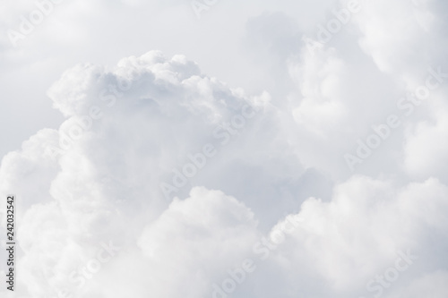 View on a soft white fluffy clouds as background, texture (abstract) - 242032542