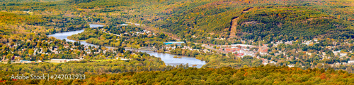 Aerial view of the City of Port Jervis, NY crossed by Upper Delaware river as viewed from High Point peak, NJ