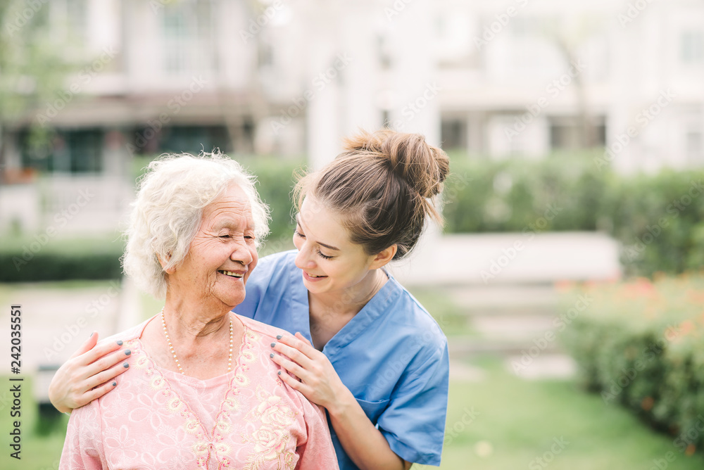 Fototapeta Caregiver with Asian elderly woman outdoor