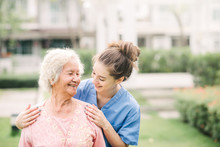 Caregiver With Asian Elderly W...