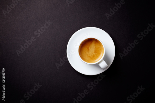 Fototapeta  Cup of coffee on black background. Top view. Copy space.