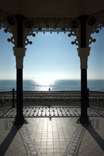 View Of Brighton Bandstand And The Sun Shining On A Blue Sea And Blue Sky, United Kingdom,