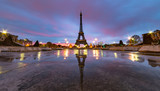 Fototapeta Fototapety z wieżą Eiffla - Sunrise on the Eiffel tower reflection on the Trocadero fountain water in Paris, one of the most visited building by the tourists