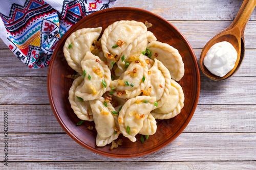 Dumplings, filled with cabbage. Varenyky, vareniki, pierogi, pyrohy - dumplings with filling. View from above, top studio shot