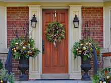 Wooden Front Door With Wreath And Festive Decorations