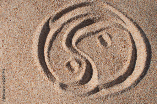 Acrylic Prints Stones in Sand drawn on the sand sign Yin Yang