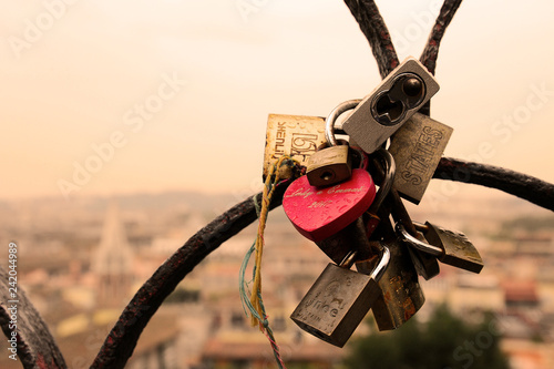 Rome, Italy - October  12, 2018: Lovers padlocks on a bridge Wallpaper Mural