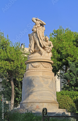 Fotografie, Obraz  Public XIX century sculpture of the famous British poet Lord Byron crowned by personification of Greece in the National Garden in Athens, Greece with blue sky copy space
