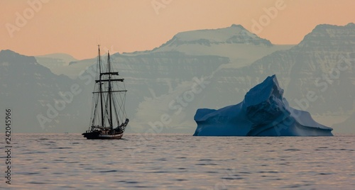 Montage in der Fensternische Grau two mast classic sailing boat among arctic snow covered landscape