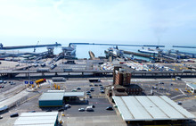 Busy Port Of Dover Docks . Cars And Trucks With Cargo Queuing To Embark Ferry For Channel Crossing .