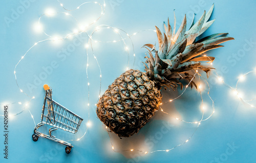 Fresh pineapple with Fairy lights and shopping cart