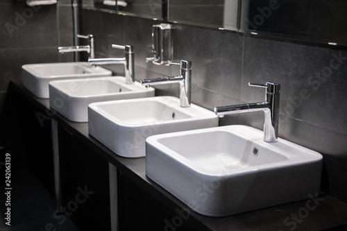 Fotografie, Tablou Modern sinks with mirror in public toilet
