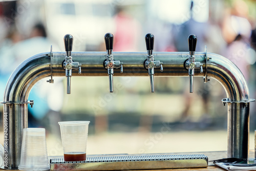 Foto op Canvas Bier / Cider Close-up of craft beer taps