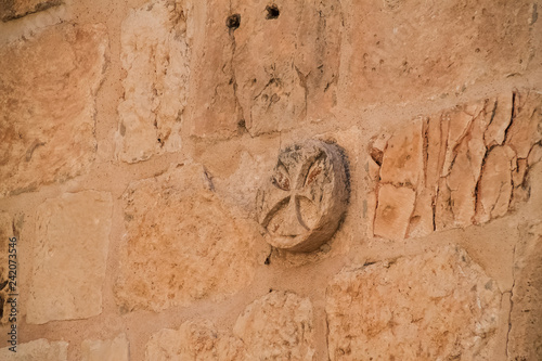 Fototapeta Ancient cross carving on brick wall in Jerusalem