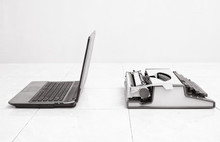 Typewriter And Laptop In Comparing Between Low And High Business Equipment. Concept Of Technology Progress.Old Vs New.Past Vs Present.