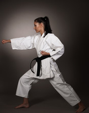 Woman In White  Kimono Punch Hard In The Air -  A Karate Martial Art Girl