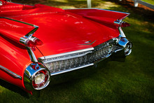 Back View Of A Red Cadillac De...
