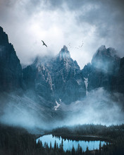 Fog Covered Lake Surrounded By...
