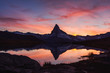 Leinwandbild Motiv Incredible colorful sunset on Stellisee lake with Matterhorn Cervino peak in Swiss Alps. Zermatt resort location, Switzerland. Landscape photography