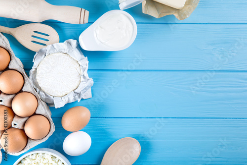 Fotobehang Zuivelproducten dairy products on blue wooden background