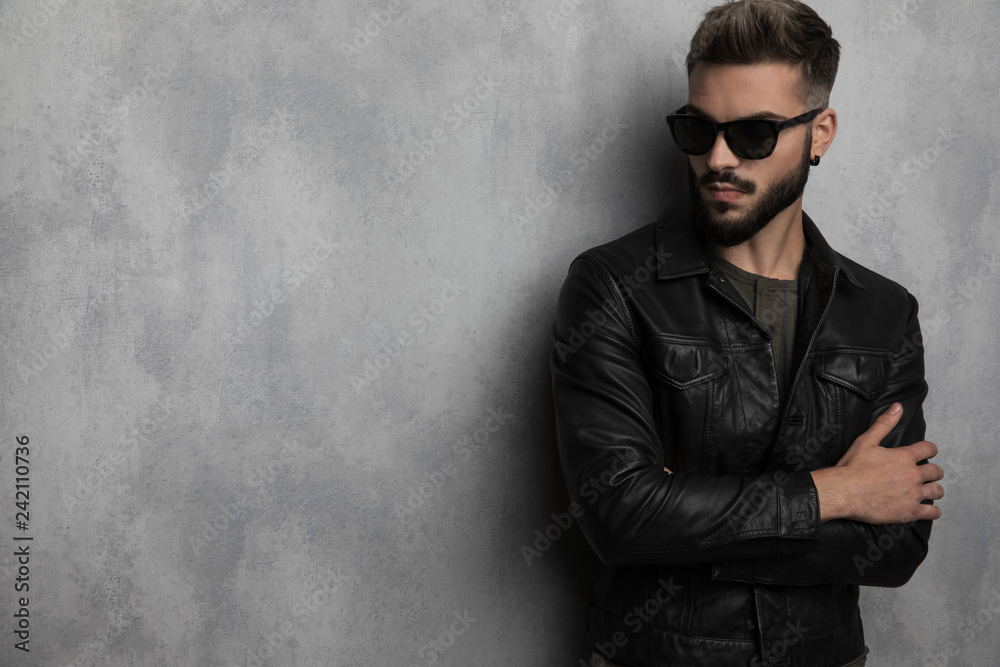 Fototapeta portrait of confident man in leather jacket looking to side