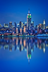 New York skyline with water reflections at night