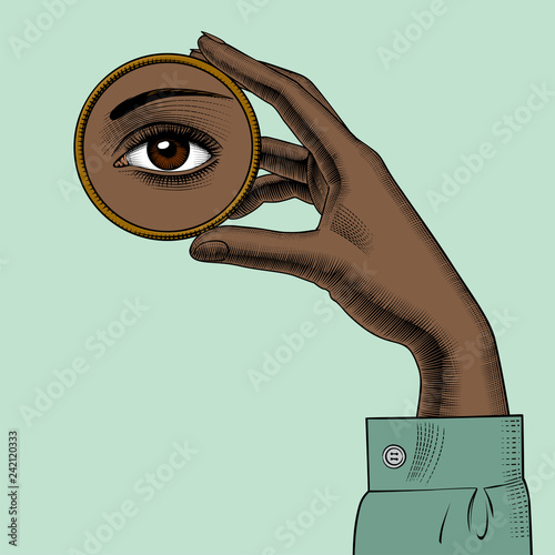 African American pretty girls. Black beauty concept. Female hand holding in fingers a round small mirror with a reflection of her eye. Vintage engraving stylized drawing. Vector Illustration