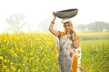 Female Indian Farmer Carrying ...