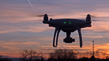 A Drone Hovers In Flight In Fr...