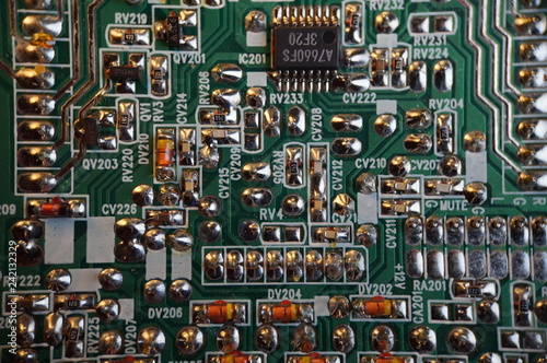 Fotografiet  Circuit board background. Electronic hardware. Close up.