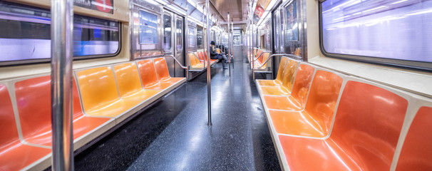 NEW YORK CITY - DECEMBER 2018: Interior of New York City subway train, wide angle view