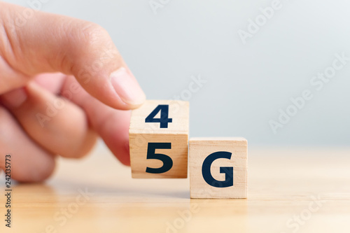 Fototapety, obrazy: 5G (5th Generation) network connecting technology future global. Hand flip wood cube change number 4G to 5G