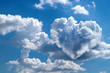 Leinwandbild Motiv Heart shaped clouds on blue sky. Love concept
