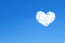 Heart Shaped Clouds On Blue Sky. Love Concept