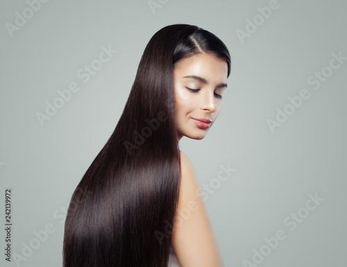Fototapeta Brunette woman with long healthy shiny straight hair, fashion portrait