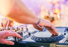 Dj Mixing At Beach Party Festival With People Dancing In The Background - Deejay Playing Music Mixer Audio Outdoor - Concept Of Summer Events And Club Outdoor