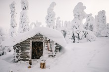 Winter Snow Covered Wood Hut. ...