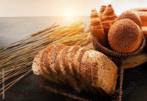 Foto op Aluminium Brood Fresh baked bread and baguette on wooden background