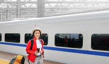 Solo Travelling , Middle Aged Asian Female Tourist Travel With High-speed Train