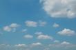 blue sky , cumulus fluffy clouds