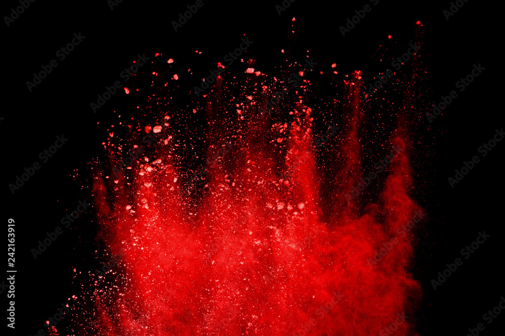 Fototapety, obrazy: Red powder explosion isolated on black background.