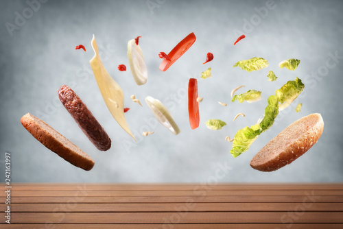 Classic beef burger floating on wood table and gray background