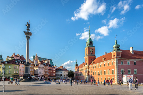 Fototapety, obrazy: Warsaw, Poland - July 10th 2018 - Tourists having fun in a large square in the old town of Warsaw in a late afternoon
