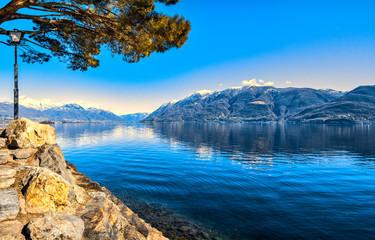 Fototapeta Rzeki i Jeziora Panorama view of the small town Brissago and Maggiore lake in Ticino, Switzerland