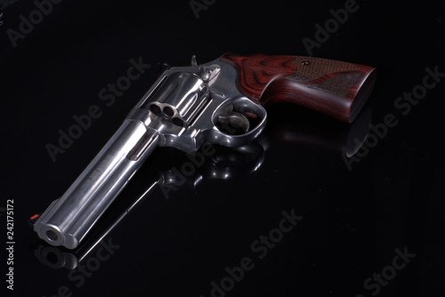 Photo Revolver on black background