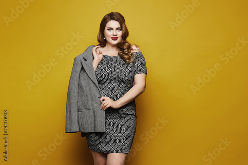 Plus size sexy model girl, fashionable blonde with bright makeup and with stylis Fototapet