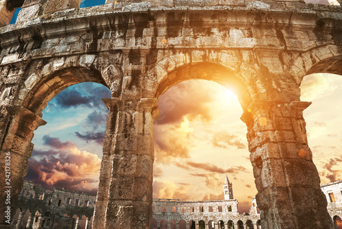 Fotografija View on church bell tower through amphitheater arches
